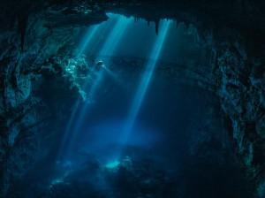 01-diver-explores-cenote-near-tulum-670